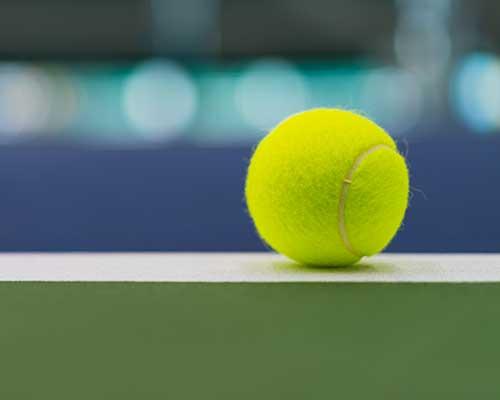 tennis-ball-on-tennis-court